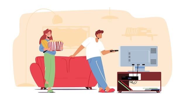 Młoda para przed telewizorem z popcornem w domu. postacie płci męskiej i żeńskiej, siedząc na kanapie razem w leniwy wieczór weekendowy. kino czas wolny, czas wolny, dzień wolny. ilustracja wektorowa kreskówka ludzie