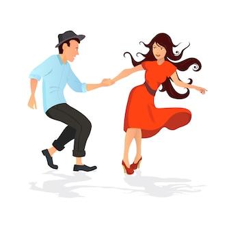 Młoda para tańczy swing, rock lub lindy hop.