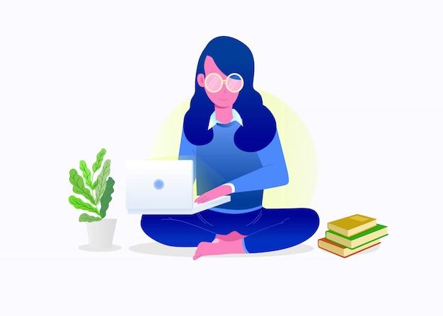 Młoda piękna dziewczyna trzyma notatnika. dziewczyna siedzi i trzyma laptopa