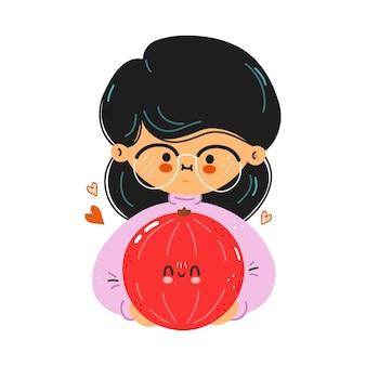 Młoda śliczna zabawna dziewczyna trzyma w ręku czerwone porzeczki