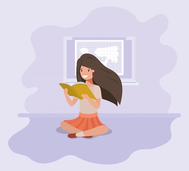 Młoda studencka dziewczyna siedzi czytelniczą książkę