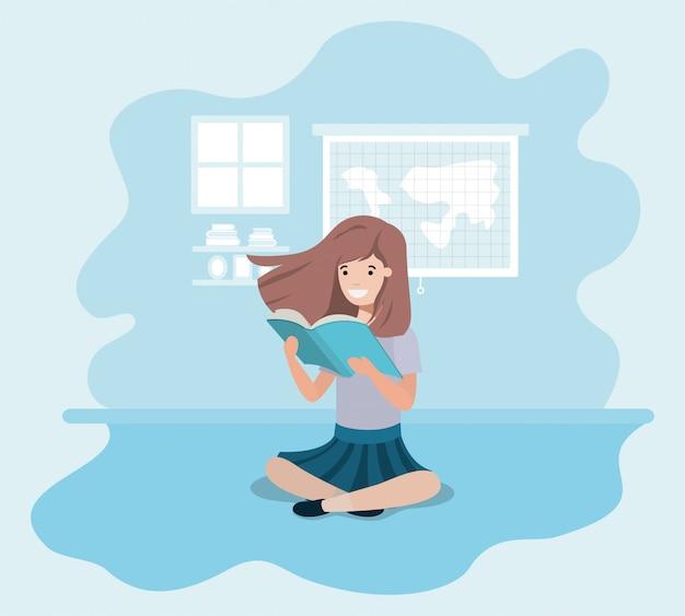 Młoda studentka dziewczyna siedzi czytając książkę