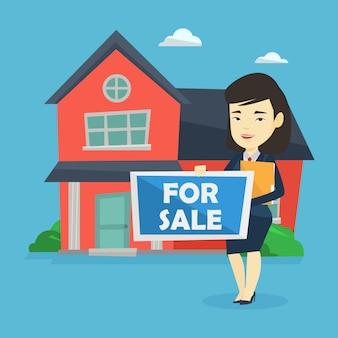 Młoda żeńska pośrednik handlu nieruchomościami oferuje dom.