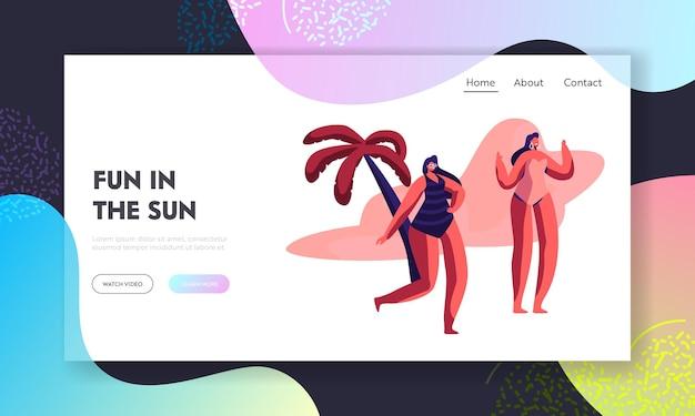 Młode dziewczyny w strojach kąpielowych i okularach przeciwsłonecznych na plaży z palmami. szablon strony docelowej witryny