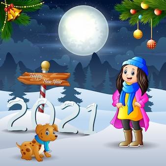 Młode kobiety bawiące się na świeżym powietrzu ze swoim zwierzakiem na śniegu