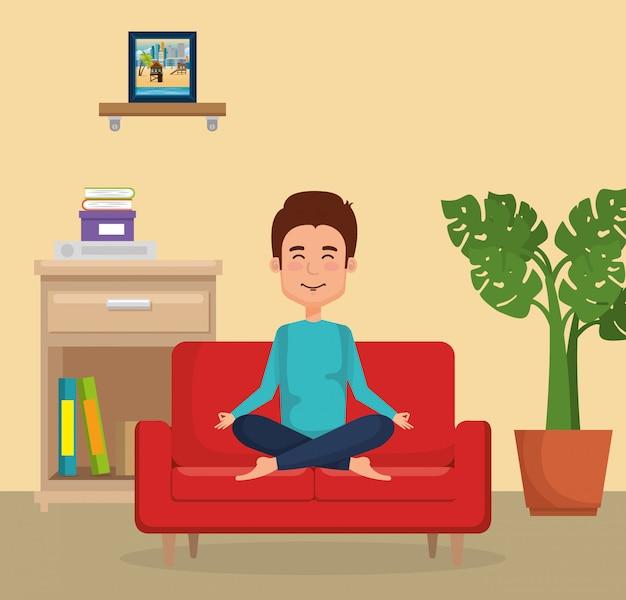 Młodego człowieka ćwiczy joga na kanapie
