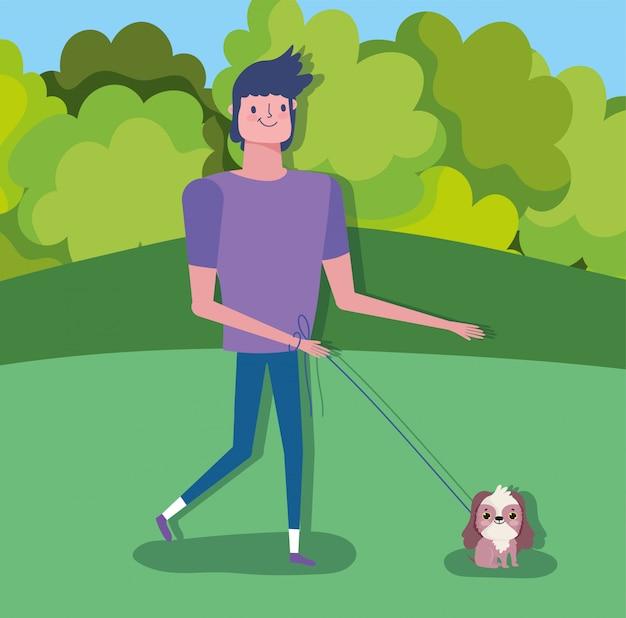 Młodego człowieka odprowadzenie z jej psim zwierzęcia domowego plenerowym zdrowym życiem