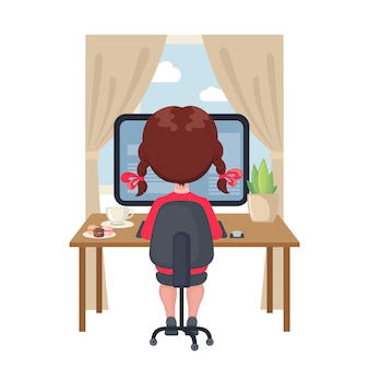Młodej dziewczyny obsiadanie przy stołem i studiowanie przy komputerem w domu.