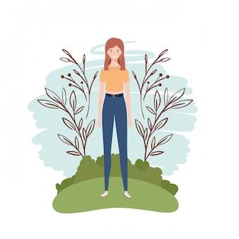 Młodej kobiety pozycja z krajobrazem