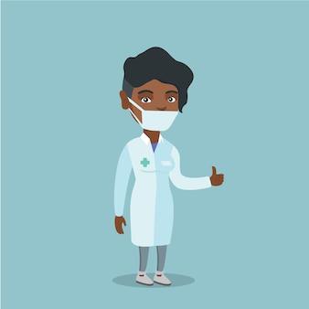 Młody afroamerykański doktorski daje kciuk up.