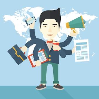 Młody, ale szczęśliwy japoński pracownik robi wielozadaniowe zadania biurowe.