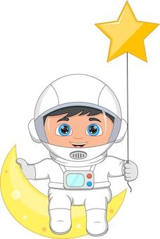 Młody astronauta siedzący na półksiężycu i trzymający gwiazdę