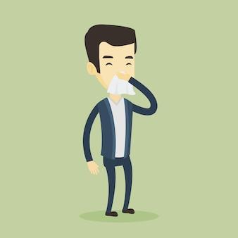 Młody azjatycki chory człowiek kichanie.