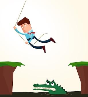 Młody biznesmen wiszące w liny, aby uniknąć przeszkody