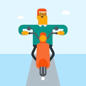 Młody caucasian biały człowiek jedzie motocykl.