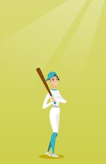 Młody caucasian gracz baseballa z nietoperzem.