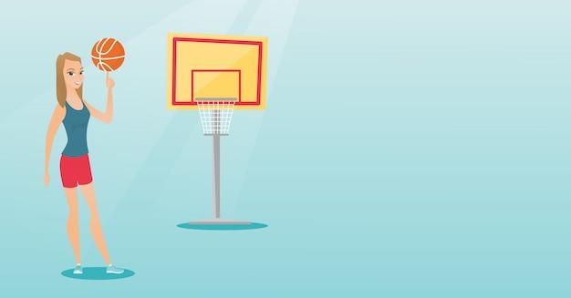 Młody caucasian gracz koszykówki wiruje piłkę.