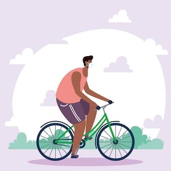 Młody człowiek afro ubrany w maskę medyczną w postaci roweru