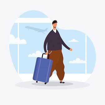 Młody człowiek dorywczo z walizką
