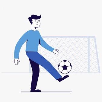 Młody człowiek, gry w piłkę nożną.