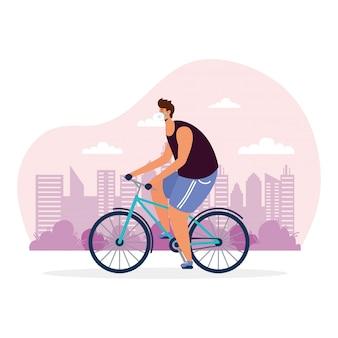 Młody człowiek jazda na rowerze sport na sobie maskę medyczną