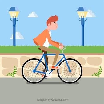 Młody człowiek jazda na rowerze z płaskim wzorem