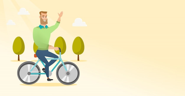 Młody człowiek jedzie rower