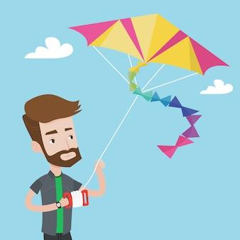Młody człowiek latający latawiec.
