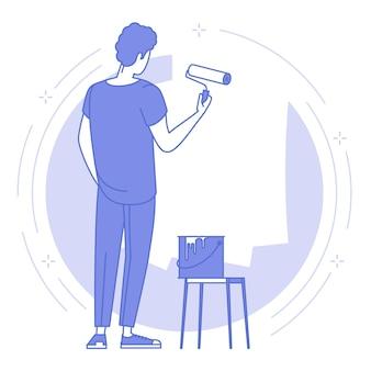 Młody człowiek malarz malowanie ścian wałkiem do malowania.