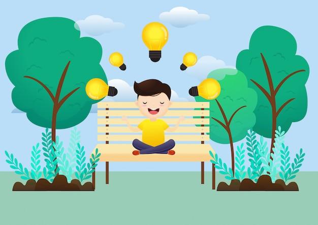Młody człowiek medytacja świetny pomysł siedzi w parku.