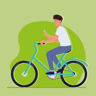 Młody człowiek na rowerze