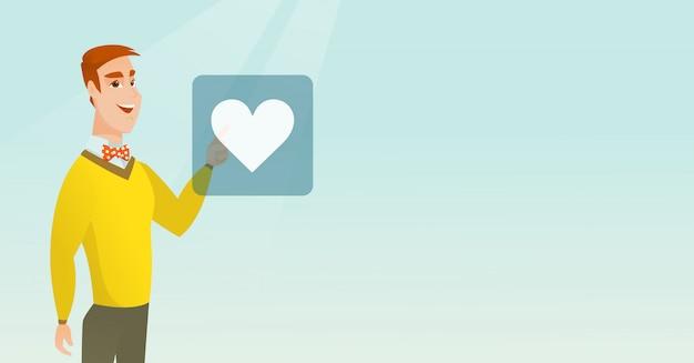Młody człowiek naciskając przycisk w kształcie serca.
