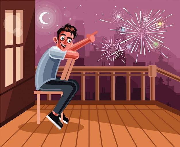 Młody człowiek ogląda fajerwerki w domu