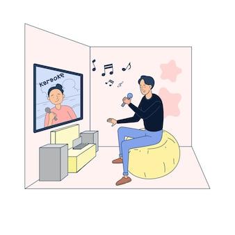 Młody człowiek ogląda i śpiewa piosenkę.