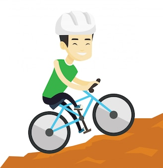 Młody człowiek podróżuje w górach na rowerze.