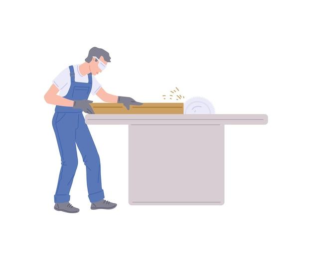 Młody człowiek producent mebli pracuje w swoim warsztacie na maszynie do obróbki drewna