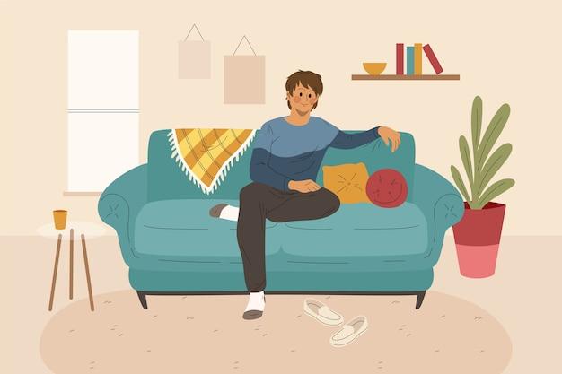 Młody człowiek relaksuje w domu
