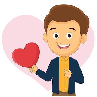 Młody człowiek trzyma czerwone serce, walentynki