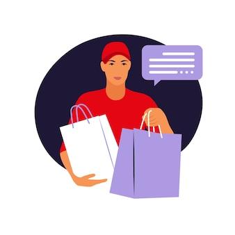 Młody człowiek usług kurierskich posiadania dużych toreb papierowych.