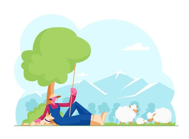 Młody człowiek w kapeluszu z plew i niebieskim kombinezonie, trzymając długi kij siedzący z psem pod drzewami pasących się owiec. płaskie ilustracja kreskówka