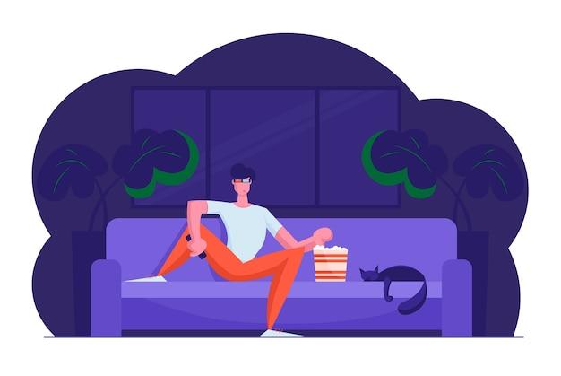 Młody człowiek w okularach 3d siedzi na domowej kanapie