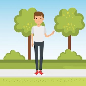 Młody człowiek w parku