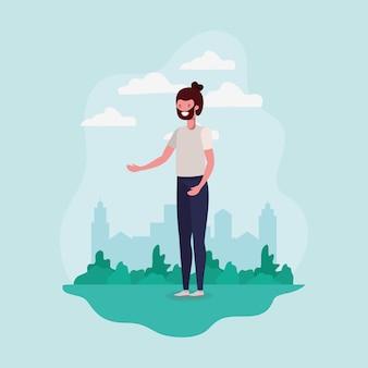 Młody człowiek z brodą stoi w parku charakter