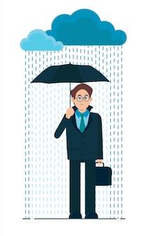 Młody człowiek z parasolem w deszczu. zła deszczowa pogoda.