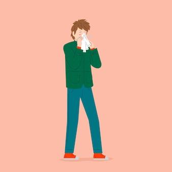 Młody człowiek z przeziębieniem