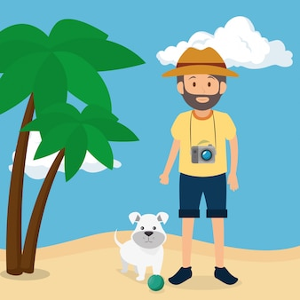 Młody człowiek z psem na plaży