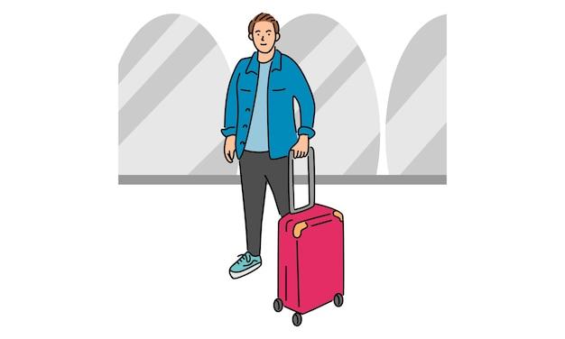 Młody człowiek z walizką
