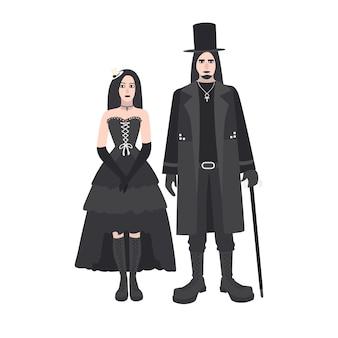 Młody goth mężczyzna i kobieta z długimi włosami ubrani w czarne ubrania stojących razem. gotycka kontrkultura lub subkultura.