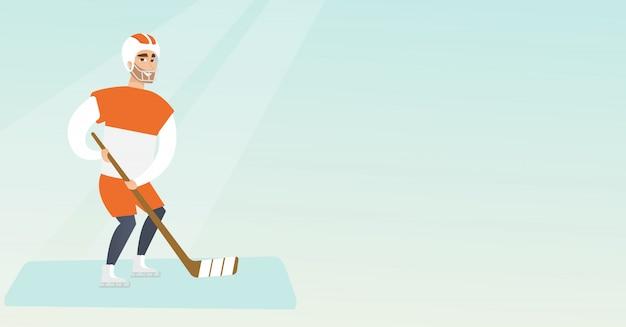 Młody kaukaski hokeista na lodzie.