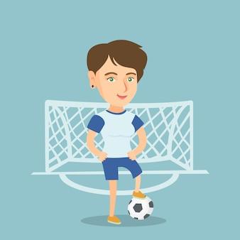 Młody kaukaski piłkarz z piłką.
